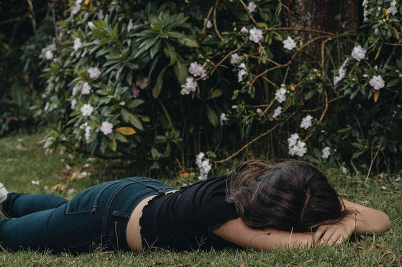 woman lying face forward in the ground