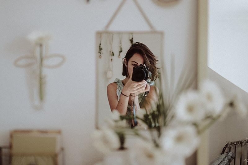 Woman selfie camera shot mirror reflection