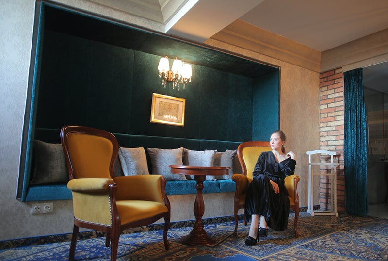 woman sitting on an armchair alone in the room