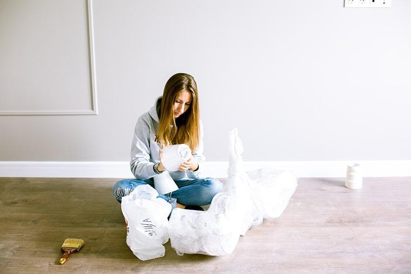 woman sitting on the floor unpacking stuff