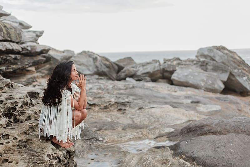 woman standing on the rock during daytime