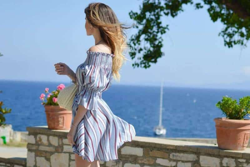 woman wearing a dress looking at the sea