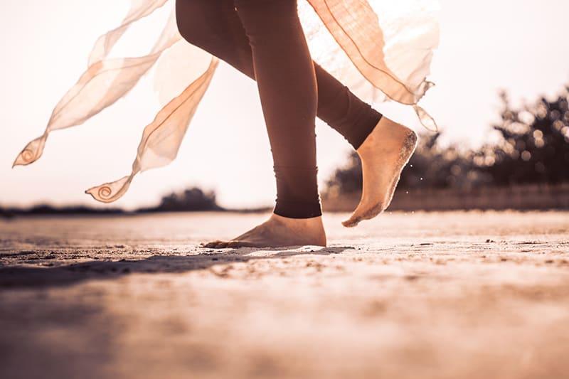 woman wearing black leggings standing barefoot