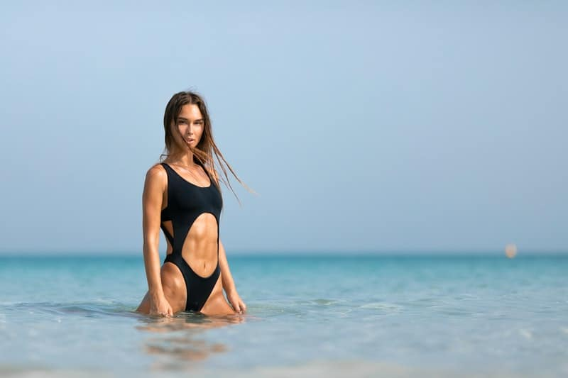 woman wearing monokini colored black in the middle of a body of water