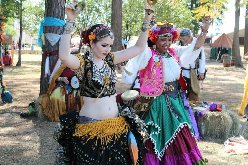 two women wearing gipsy costumes dancing