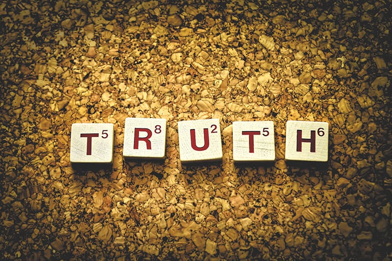word truth made of letters blocks on gold background