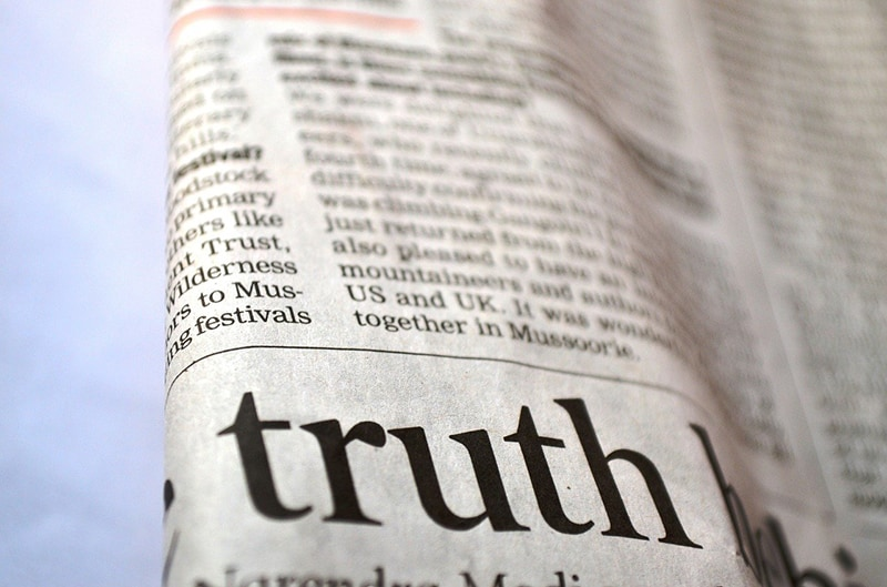 word truth zoomed in the newspaper