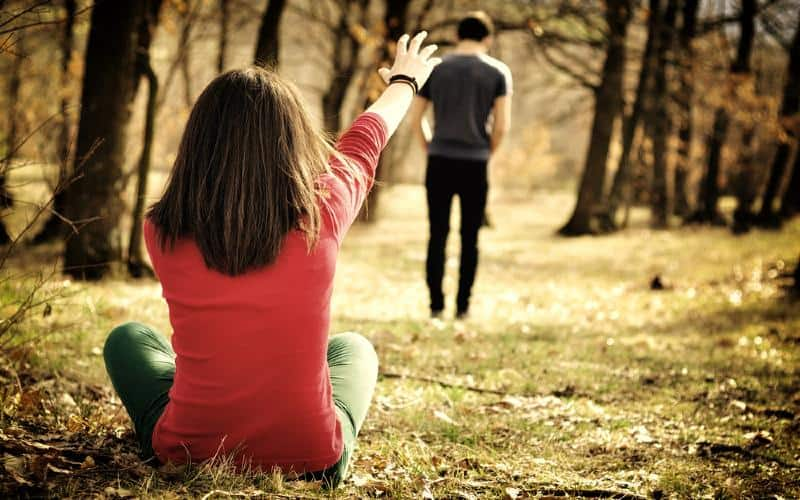 Young couple breaking up in the forest