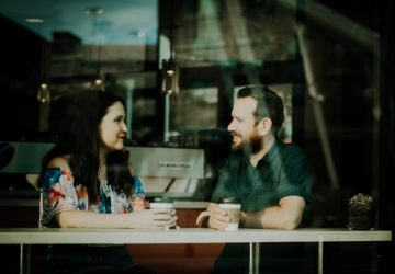 woman and man drinking coffee in a coffee shop