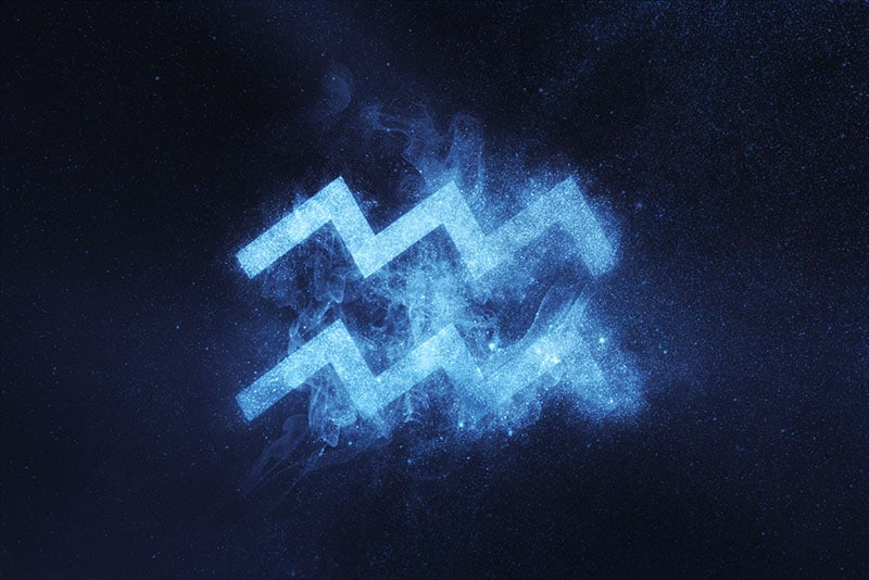 Aquarius Zodiac Sign on dark blue background