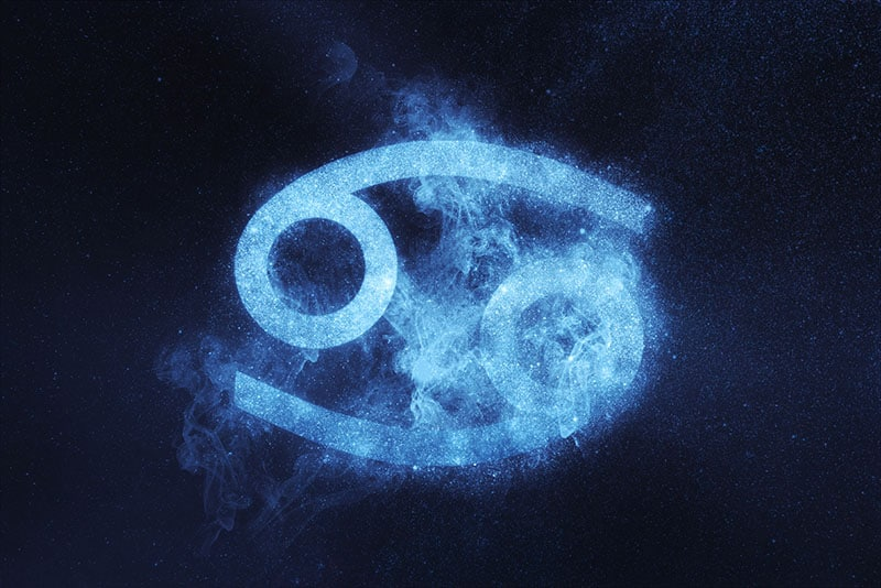 Cancer Zodiac Sign on dark blue background