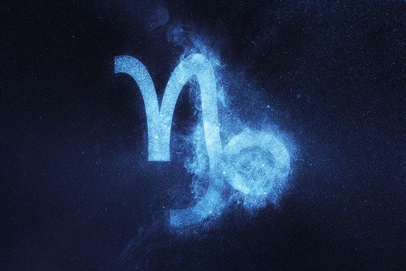 Capricorn Zodiac Sign on dark blue background