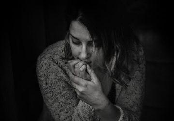 sad woman in sweater sitting indoor