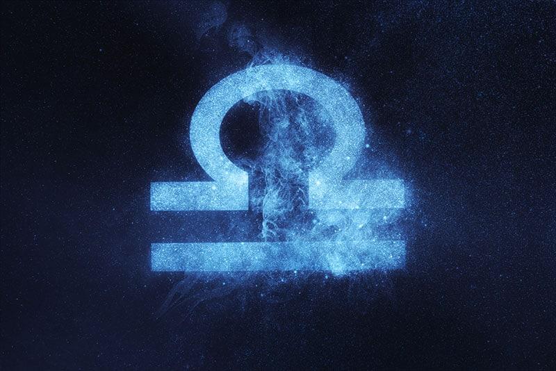 Libra Zodiac Sign on dark blue background