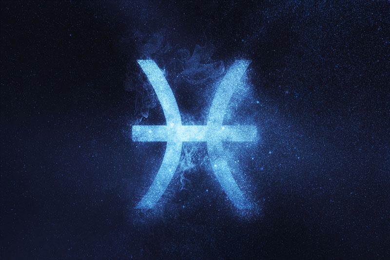 Pisces Zodiac Sign on dark blue background
