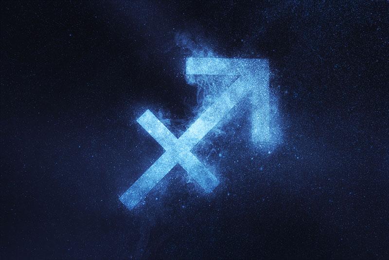 Sagittarius Zodiac Sign on dark blue background