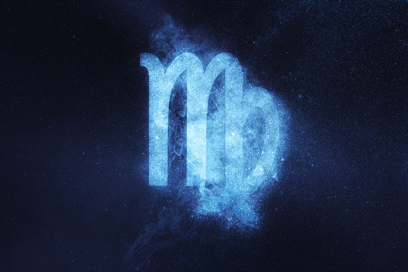Virgo Zodiac Sign on dark blue background