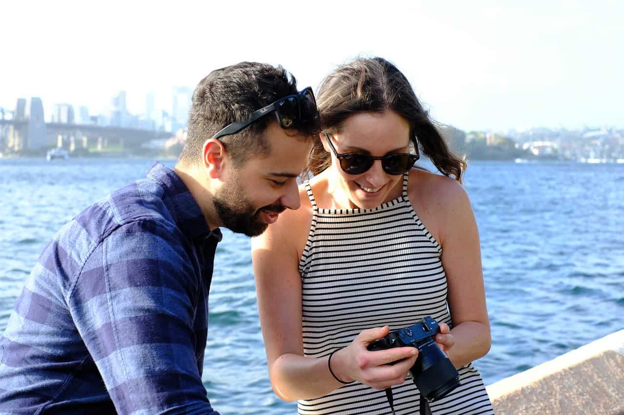 a couple in love looking at photos