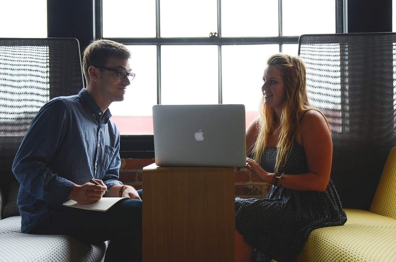 a man and a girl work on a computer
