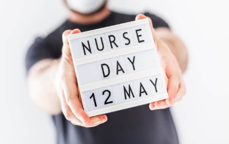 Man holding Nurse day message