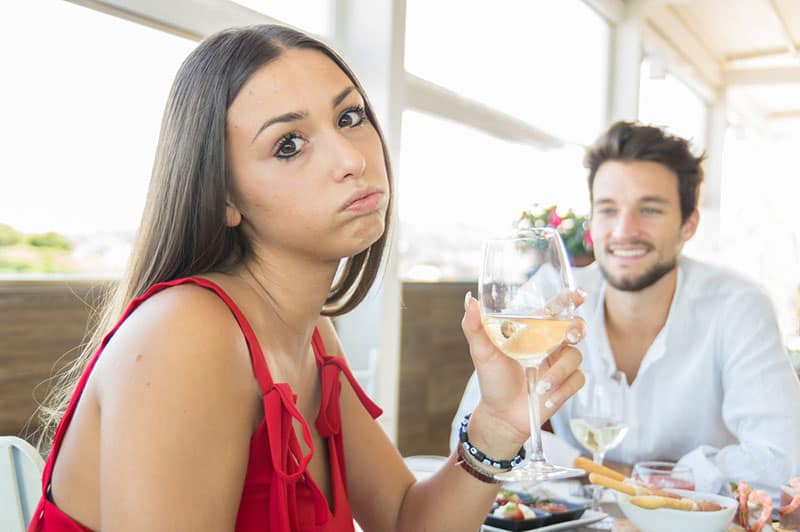 annoyed woman on date with man