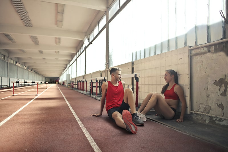 athletes resting on floor after training