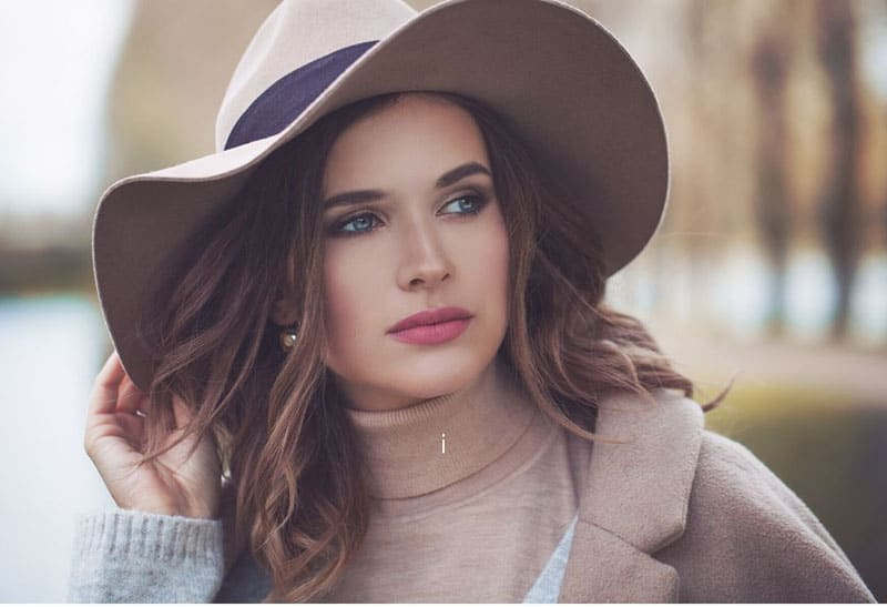 beautiful woman wearing big hat with brown jacket