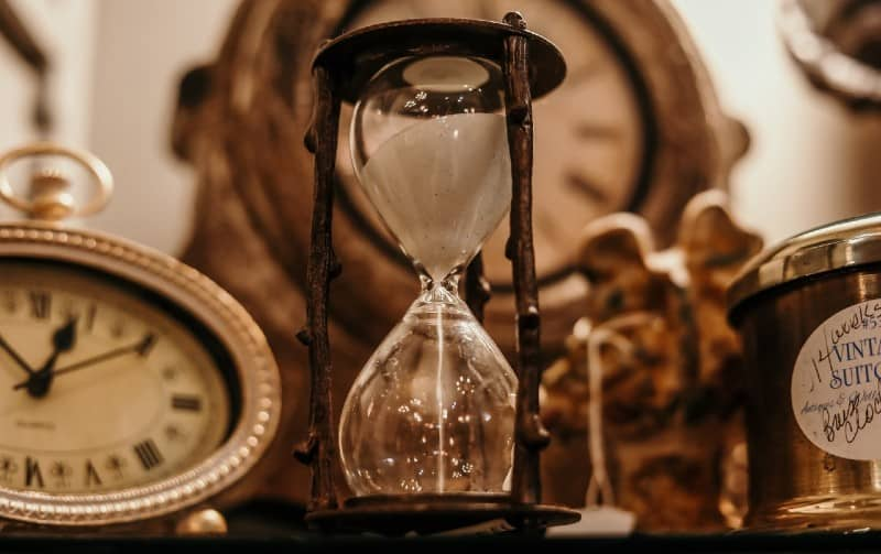 Vintage clocks and hourglass