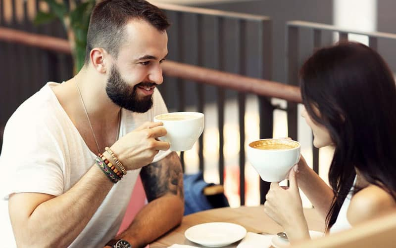 couple having a coffee date in an outside the building cafe