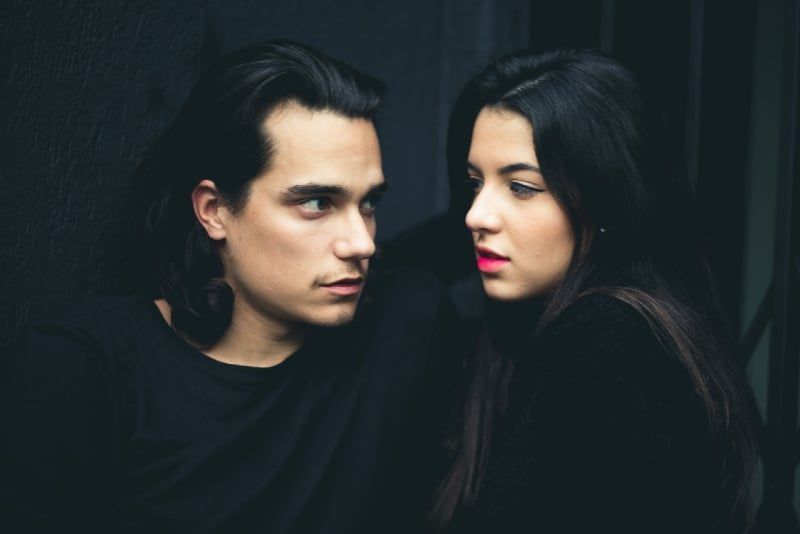 man looking at woman with red lipstick
