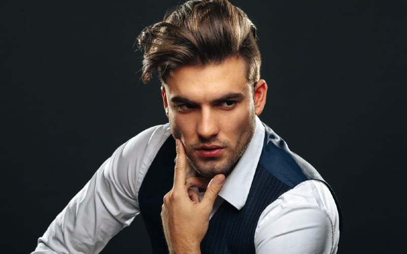 Portrait of handsome young manwearing shirt and vest