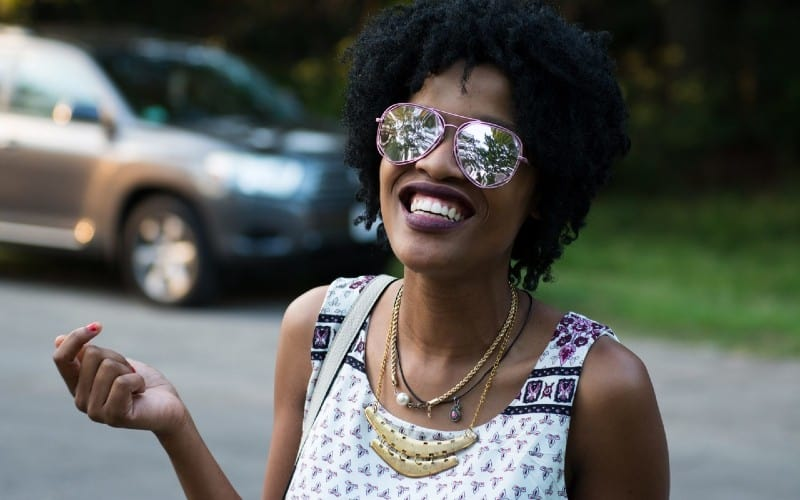 happy african american woman with sunglasses