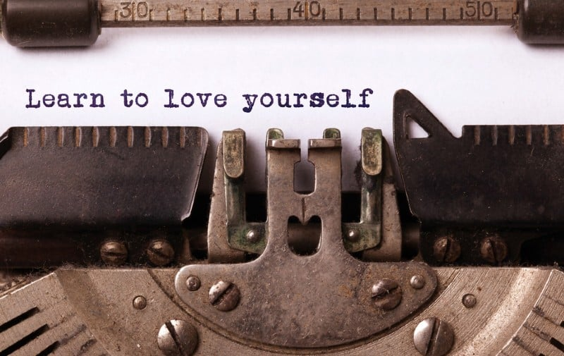 Learn to love yourself message on old typewritter