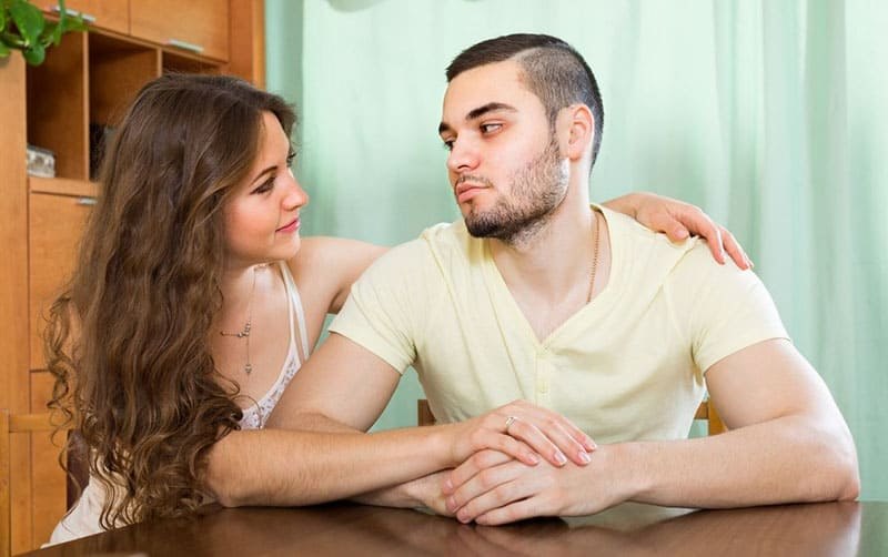 loving young woman tries to reconcile with a man after a quarrel