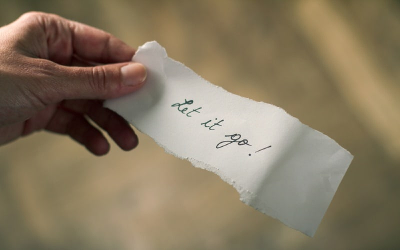 Hand holding let go note