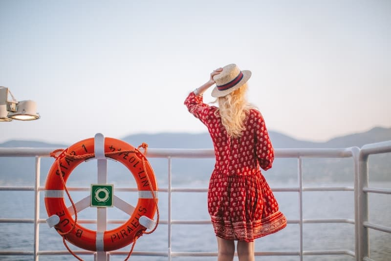 woman in red dress looking at sea