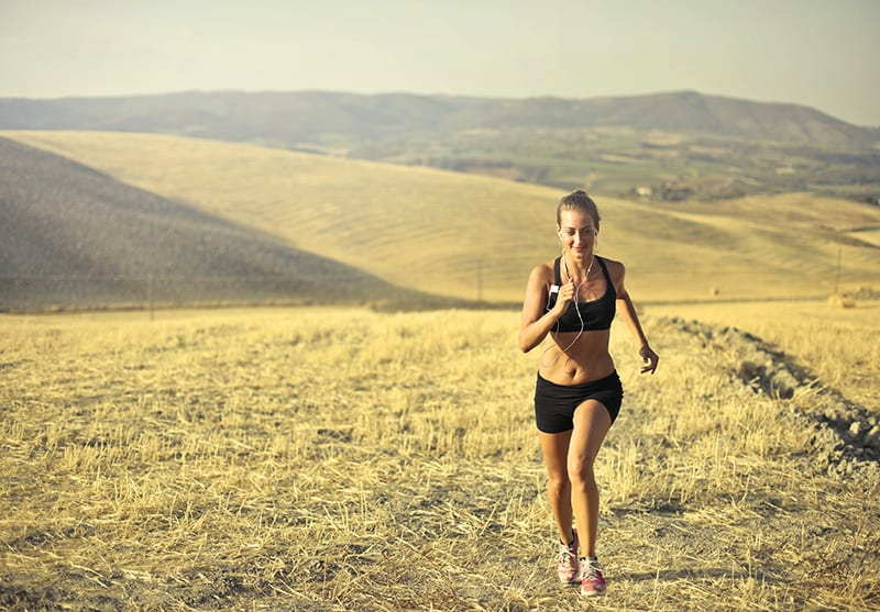 woman running along hill