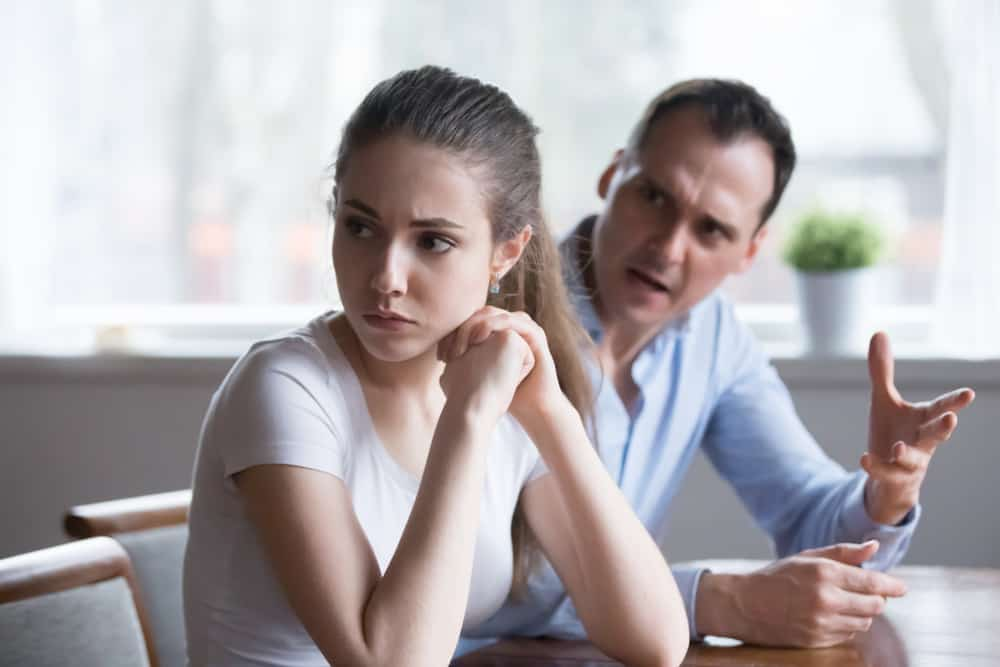 woman sitting and ignoring her man