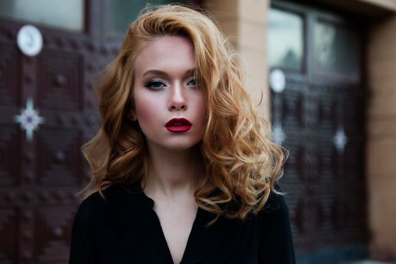 woman with red lipstick standing outdoor