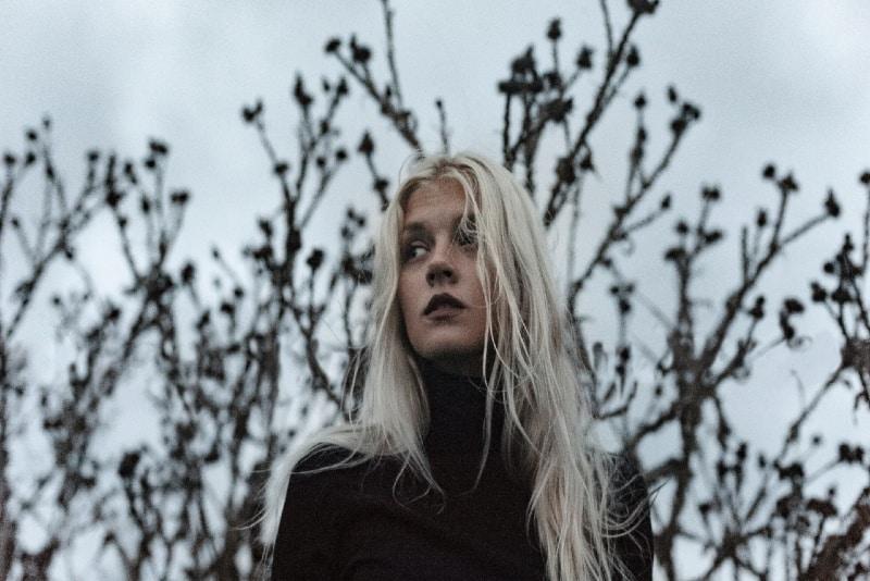 woman in black turtleneck sweater standing outdoor