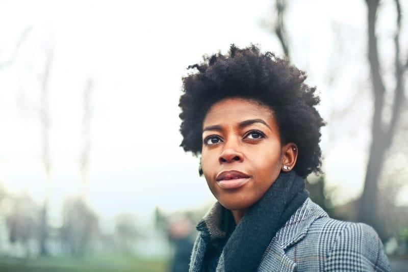 woman in gray coat standing outdoor