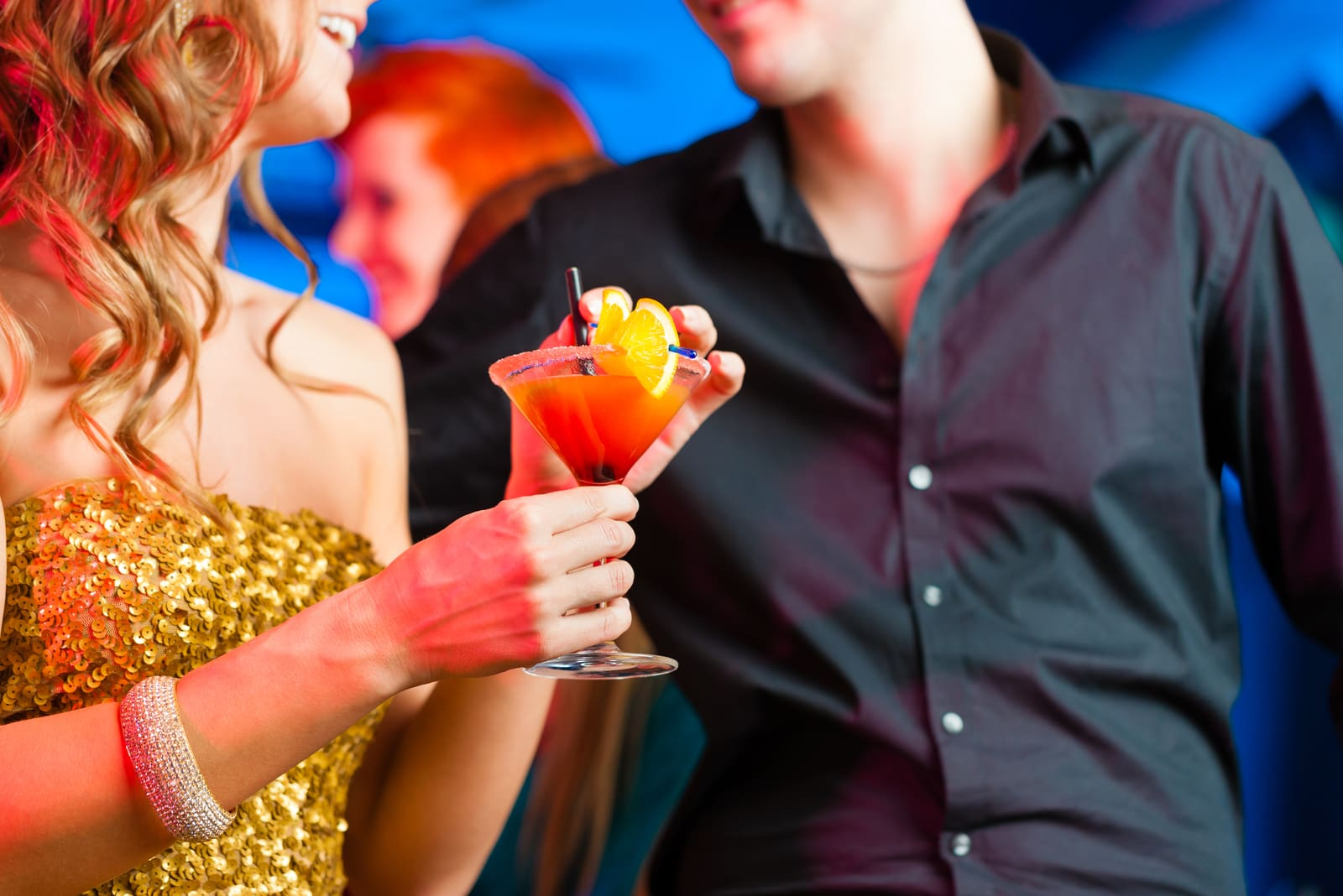 young couple drinking cocktail and celebrating