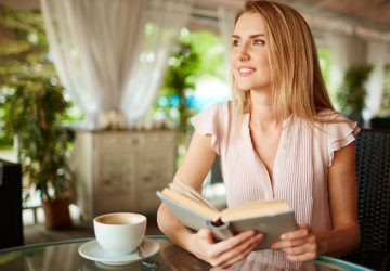 girl on coffee break with book in her hands