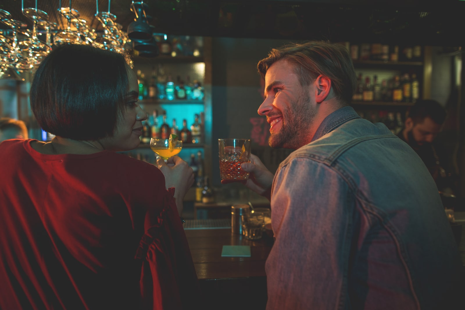 a smiling couple talking in a cafe