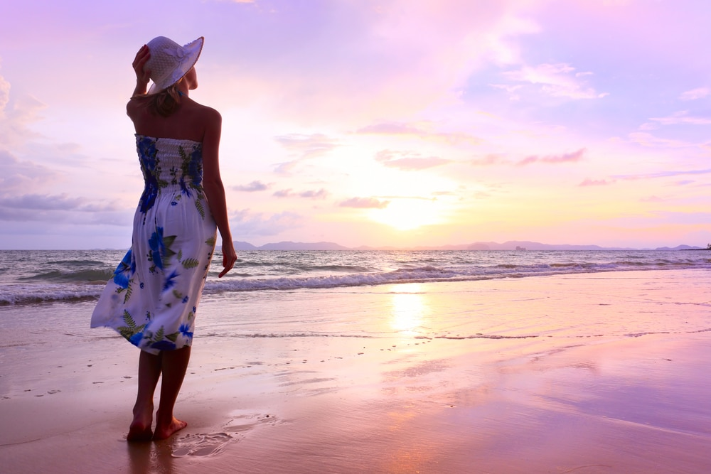a woman standing on the beach