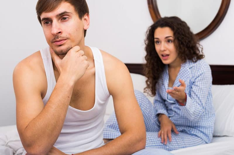 couple fighting bed with their sleeping wears on