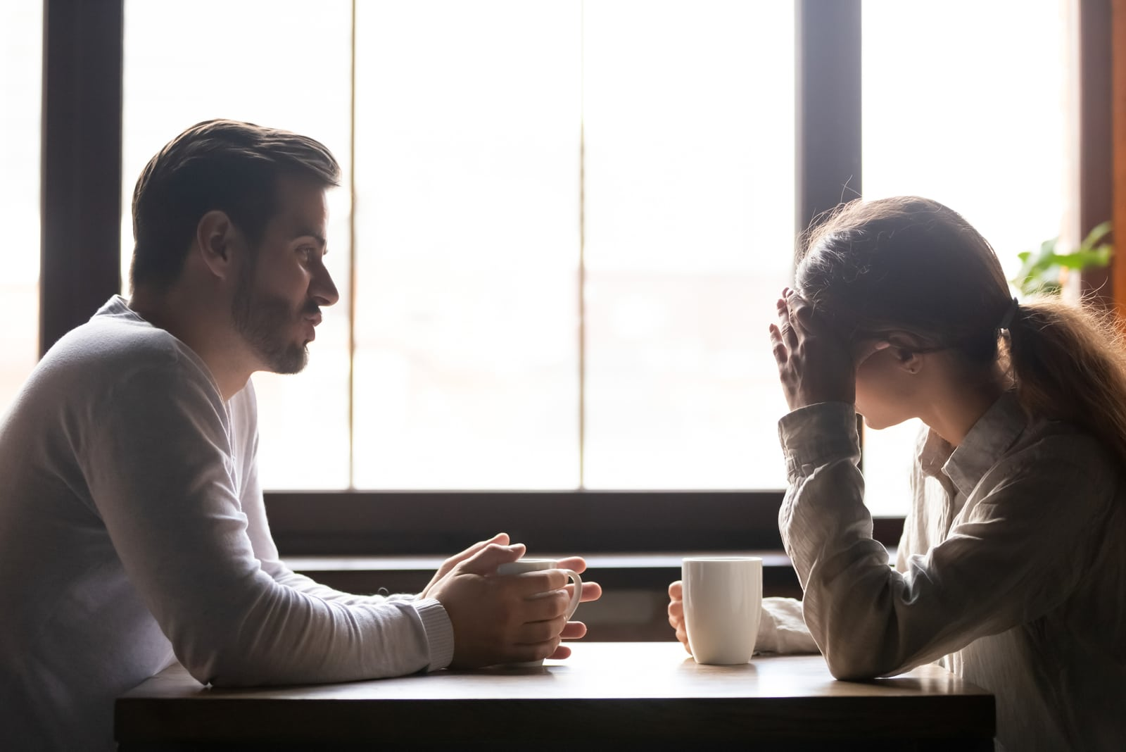 couple sitting in cafe having argument