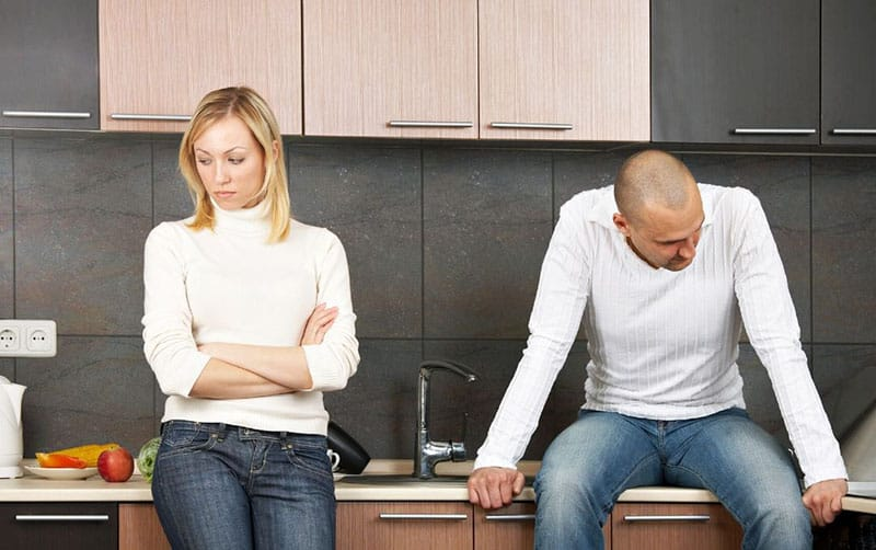 man and woman having disagreement inside the kitchen not talking to each other