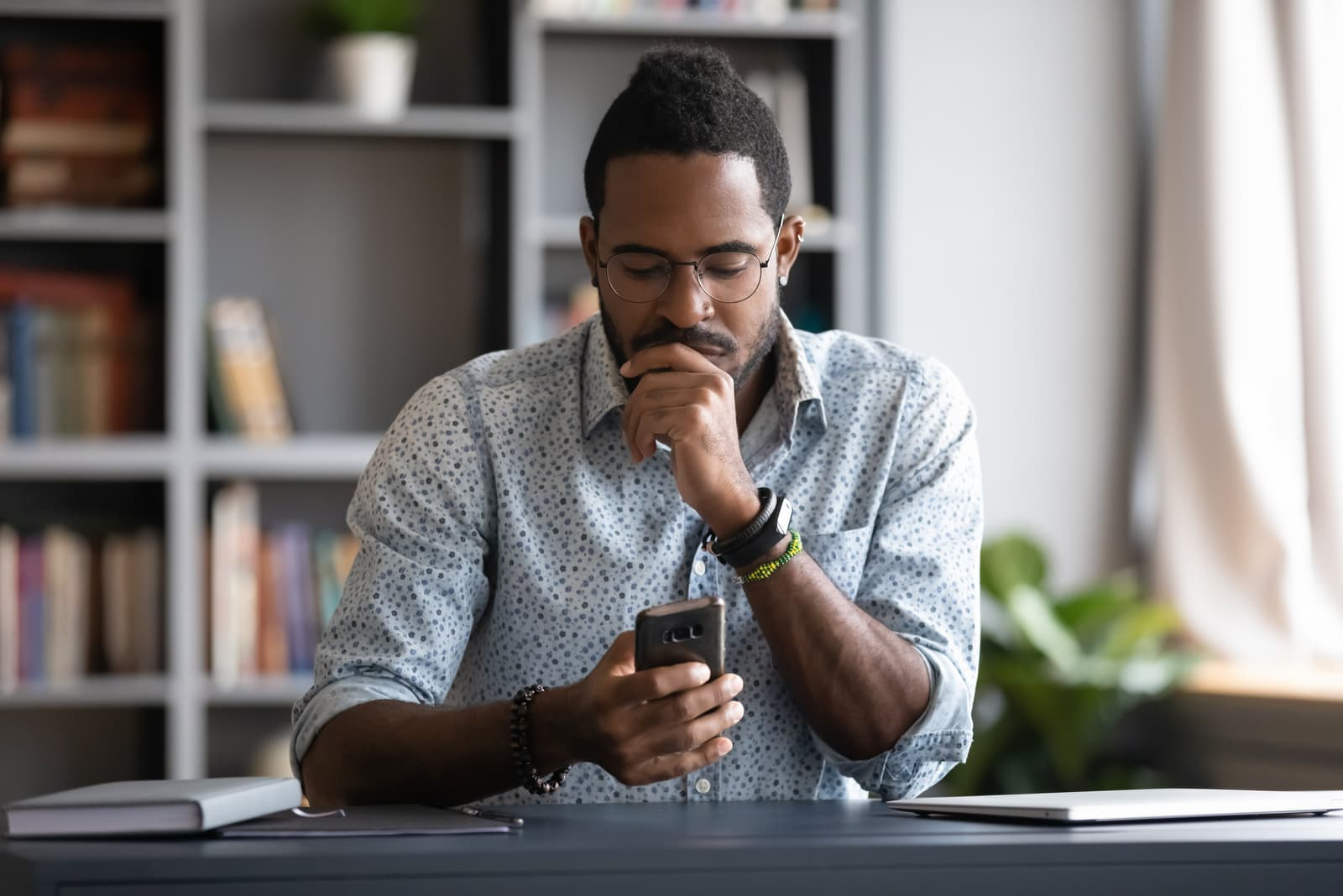 man reading sms on smartphone
