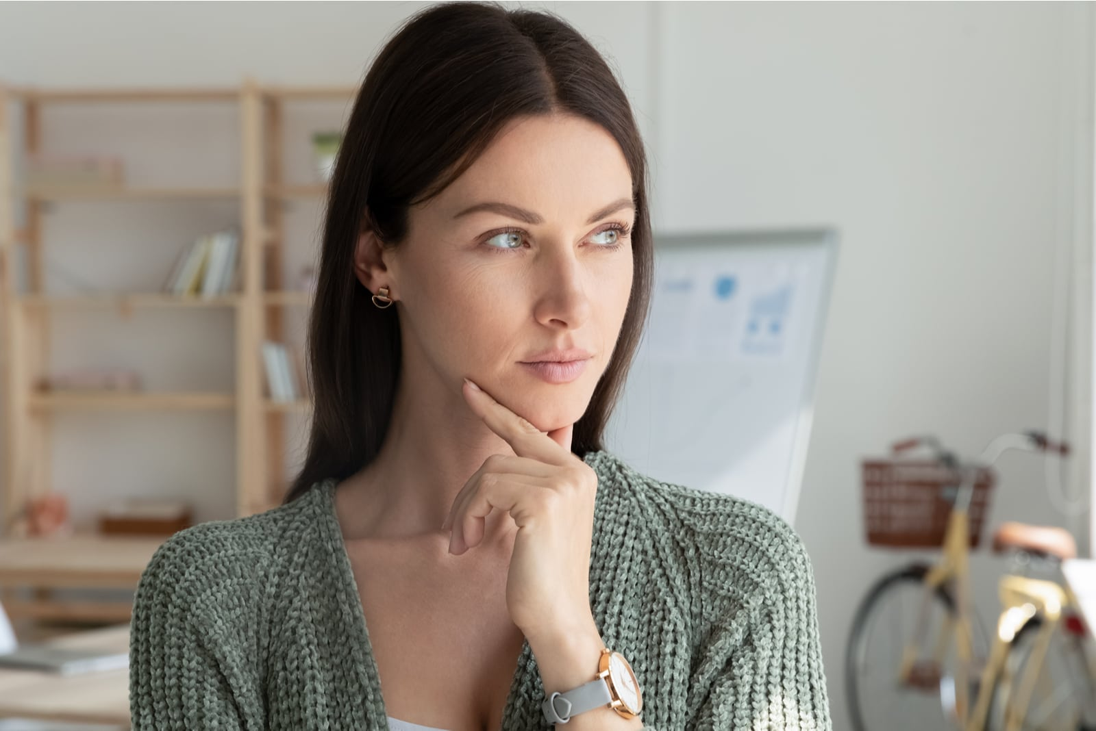 portrait of an attractive brunette in the office